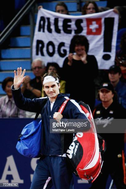 Roger Federer of Switzerland waves to his home crowd ahead of the game against Paradorn Srichaphan of Thailand during day five of the ATP Davidoff...