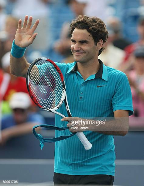 Roger Federer of Switzerland waves to the crowd after defeating Lleyton Hewitt of Australia during day five of the Western & Southern Financial Group...
