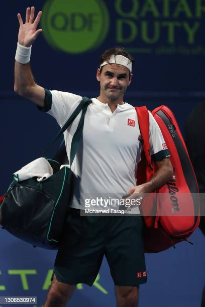 Roger Federer of Switzerland waves to the crowd after his defeat to Nikoloz Basilashvili of Georgia in the quarter final of the Qatar ExxonMobil Open...
