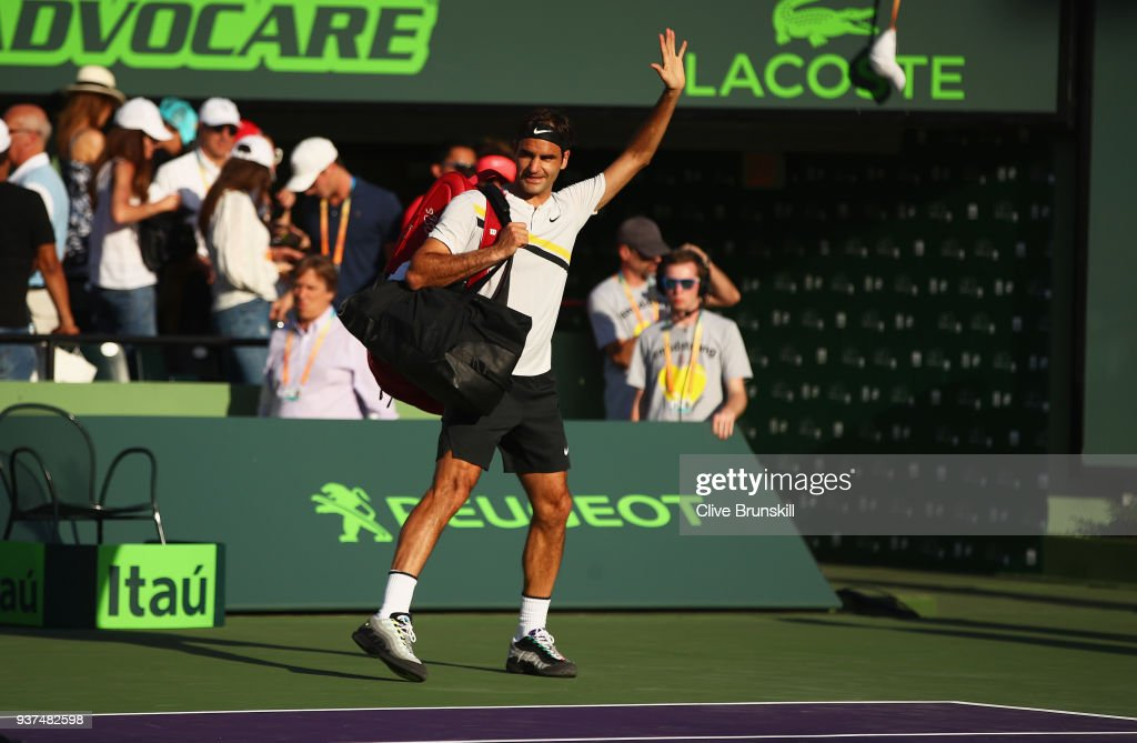 Roger Federer of Switzerland waves to the crowd after his three set defeat by Thanasi Kokkinakis of Australia in their second round match during the Miami Open Presented by Itau at Crandon Park Tennis Center on March 24, 2018 in Key Biscayne, Florida.