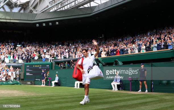 Roger Federer of Switzerland waves to the crowd after losing his men's Singles Quarter Final match against Hubert Hurkacz of Poland on Day Nine of...