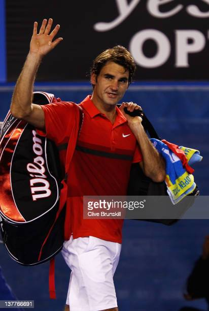 Roger Federer of Switzerland waves to the crowd after losing his semifinal match against Rafael Nadal of Spain during day eleven of the 2012...