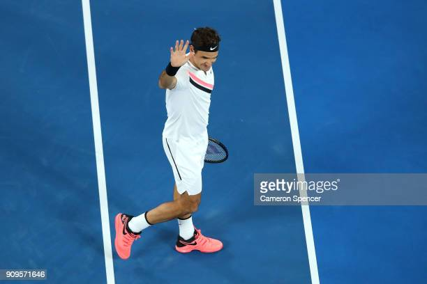Roger Federer of Switzerland waves to the crowd after winning his quarterfinal match against Tomas Berdych of the Czech Republic on day 10 of the...