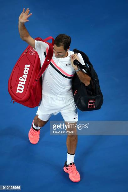 Roger Federer of Switzerland waves to the crowd after winning his semifinal match against Hyeon Chung of South Korea on day 12 of the 2018 Australian...