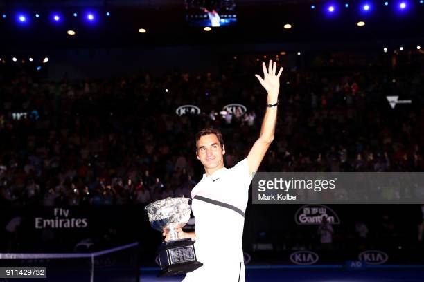 Roger Federer of Switzerland waves to the crowd as he leaves the court with the Norman Brookes Challenge Cup after winning the 2018 Australian Open...