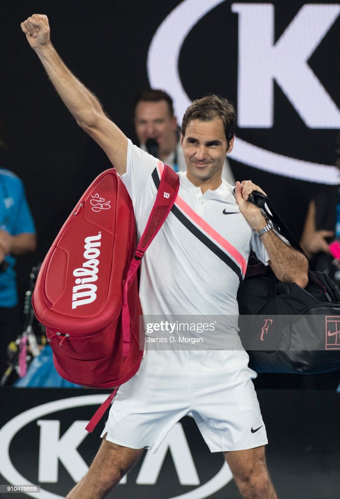 Roger Federer of Switzerland waves triumphantly to the crowd on Rod Laver Arena after his opponent, Hyeon Chung of South Korea retired injured in their semi final on day 12 of the 2018 Australian Open at Melbourne Park on January 26, 2018 in Melbourne, Australia.