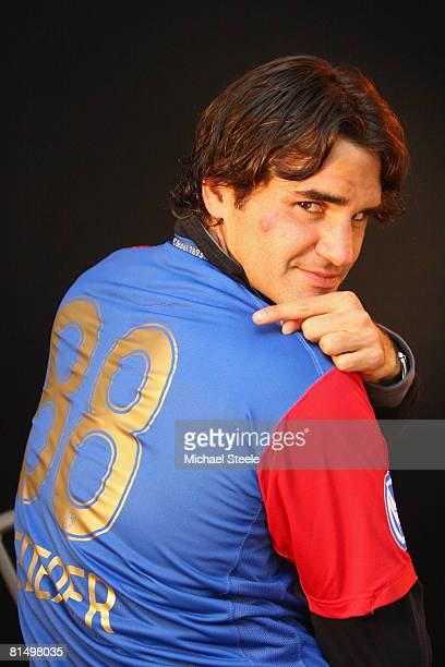 Roger Federer of Switzerland wearing a FC Basle football shirt on day six of the Masters Series at the Monte Carlo Country Club April 24 2008 in...