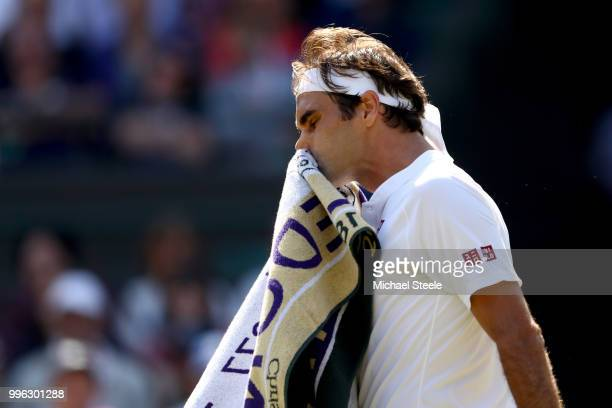 Roger Federer of Switzerland wipes his face against Kevin Anderson of South Africa during their Men's Singles QuarterFinals match on day nine of the...