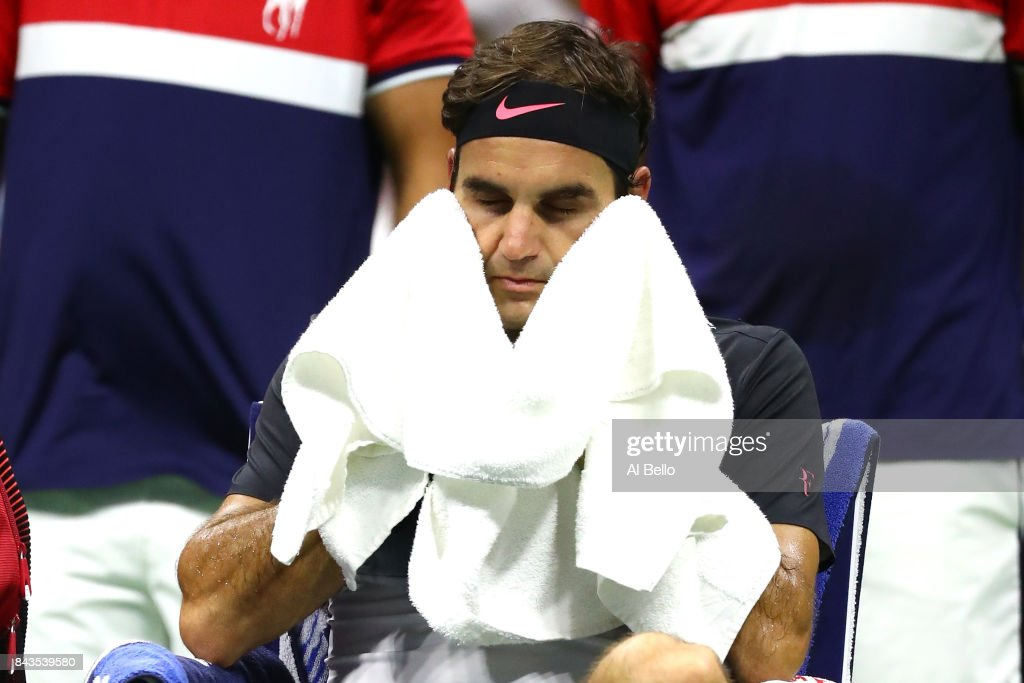 Roger Federer of Switzerland wipes his face during a break in play against Juan Martin del Potro of Argentina in their Men's Singles Quarterfinal match on Day Ten of the 2017 US Open at the USTA Billie Jean King National Tennis Center on September 6, 2017 in the Flushing neighborhood of the Queens borough of New York City.