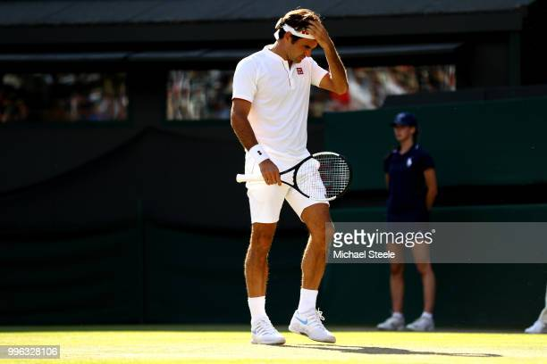 Roger Federer of Switzerland wipes his forehead against Kevin Anderson of South Africa during their Men's Singles QuarterFinals match on day nine of...