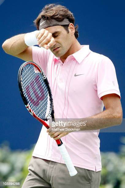 Roger Federer of Switzerland wipes his forehead between points against Andy Murray of Great Britain during the final of the Rogers Cup at the Rexall...