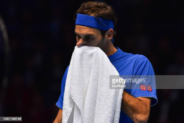 Roger Federer of Switzerland wipes off his face during his round robin match against Kevin Anderson of South Africa during Day Five of the Nitto ATP...