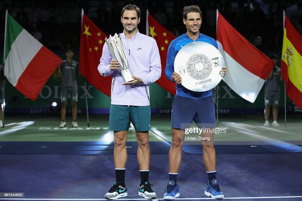Roger Federer of Switzerland with Rafael Nadal of Spain pose with their trophy after the Men's singles final mach on day eight of 2017 ATP Shanghai Rolex Masters at Qizhong Stadium on October 15, 2017 in Shanghai, China.