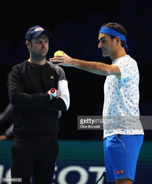 Roger Federer of Switzerland with team member Severin Luthi during a training session prior to the Nitto ATP World Tour Finals at O2 Arena on on...