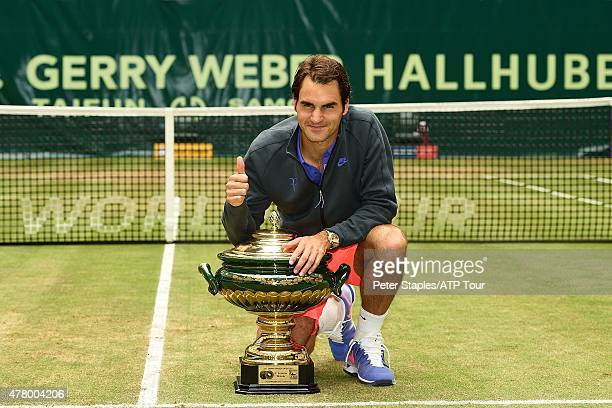 Roger Federer of Switzerland with the Championship Trophy after defeating Andreas Seppi of Italy at the Gerry Weber Open, on June 21, 2015 in Halle,...