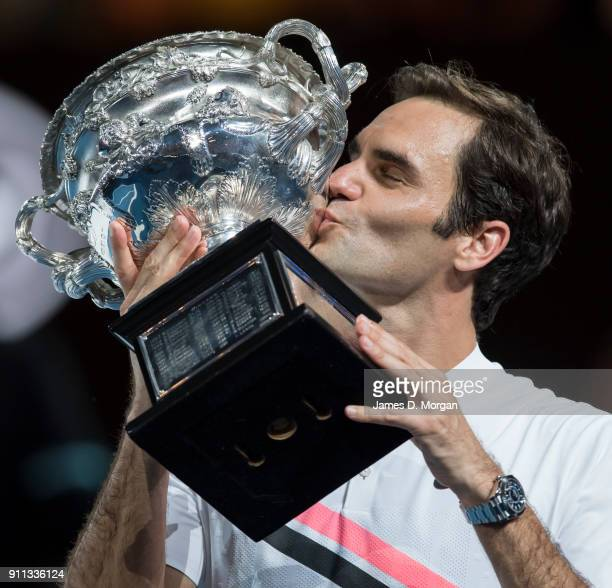 Roger Federer of Switzerland with the men's singles trophy after defeating Marin Cilic of Croatia on day 14 of the 2018 Australian Open at Melbourne...