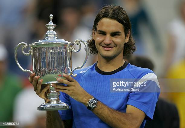 Roger Federer of Switzerland with the trophy after defeating Lleyton Hewitt of Australia in the men's final match of the US Open on September 12 2004...