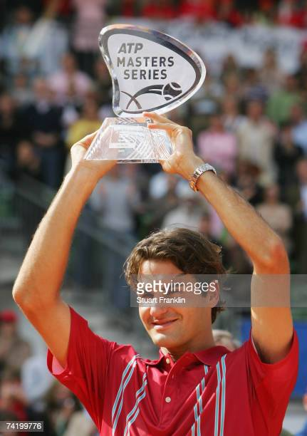 Roger Federer of Switzerland with the trophy after winning the final match against Rafael Nadal of Spain during day seven of the Tennis Masters...