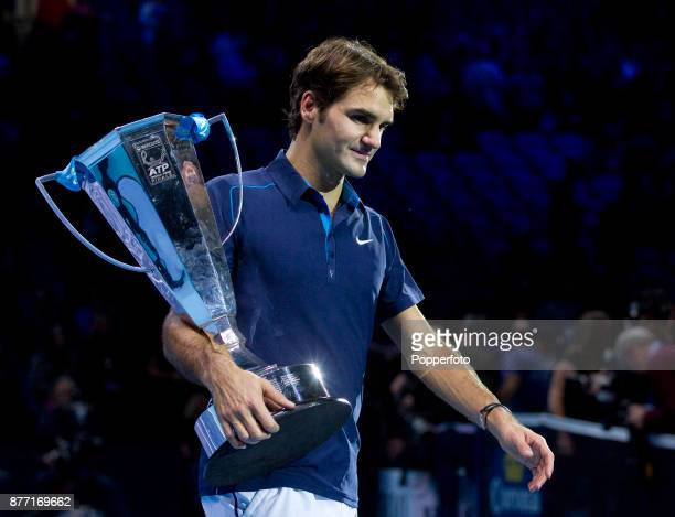 Roger Federer of Switzerland with the trophy following his victory during the men's final singles match against JoWilfried Tsonga of France during...