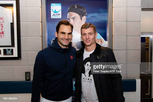 Roger Federer of Switzerland with Toni Kroos German professional footballer who plays for Spanish club Real Madrid and the German national team at...