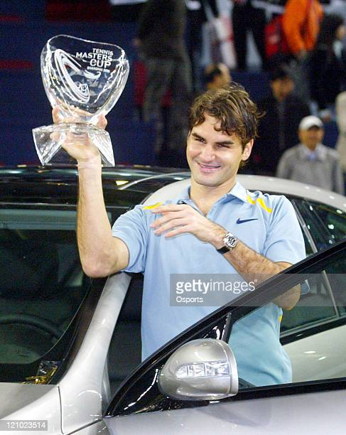 Roger Federer of Switzerland with trophy after defeating James Blake of the US in the 2006 Masters Cup tennis tournament played at the Qi Zhong...