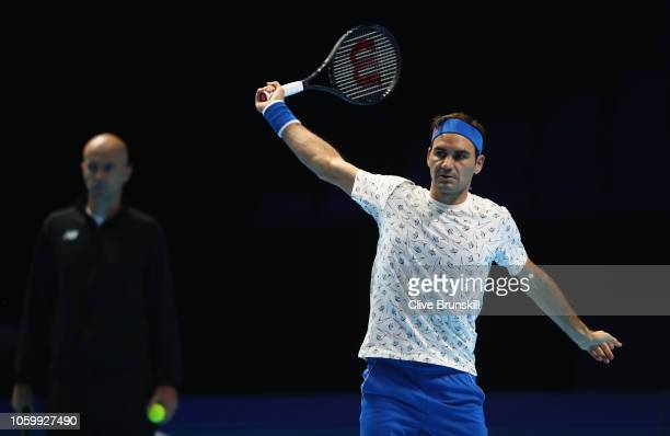 Roger Federer of Switzerlannd in action watched by coach Ivan Ljubcic during a training session prior to the Nitto ATP World Tour Finals at O2 Arena...