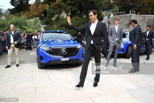 Roger Federer of Team Europe acknowledges fans as he arrives at Palais Eynard for the official welcome ceremony prior to the Laver Cup 2019 at...