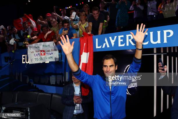 Roger Federer of Team Europe acknowledges the fans as he celebrates after winning the Laver Cup during Day Three of the Laver Cup 2019 at Palexpo on...