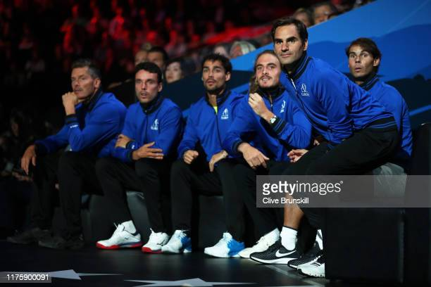 Roger Federer of Team Europe and teammates watch from the courtside in the singles match between Dominic Thiem of Team Europe and Denis Shapovalov of...