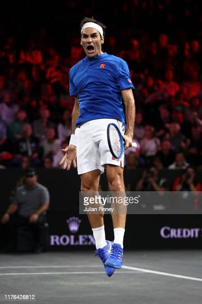 Roger Federer of Team Europe celebrates defeating John Isner of Team World during Day Three of the Laver Cup 2019 at Palexpo on September 22, 2019 in...