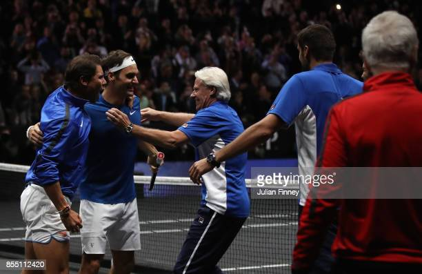 Roger Federer of Team Europe celebrates defeating Nick Kyrgios of Team World with Captain Bjorn Borg and Rafael Nadal during the final day of the...