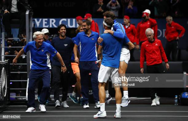 Roger Federer of Team Europe celebrates with Rafael Nadal and Bjorn Borg of Team Europe after winning the Laver Cup on match point during his mens...