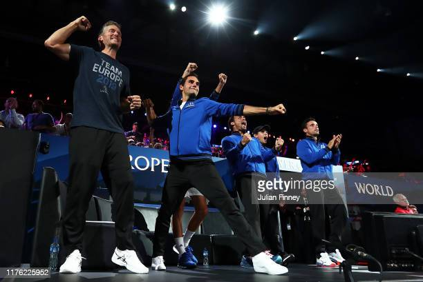 Roger Federer of Team Europe celebrates with team mates as Rafael Nadal of Team Europe defeats Milos Raonic of Team World during Day Two of the Laver...
