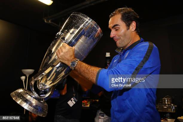 Roger Federer of Team Europe drinks champagne from Laver Cup trophy after winning the Laver Cup on the final day of the Laver cup on September 24...