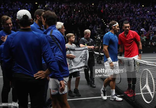 Roger Federer of Team Europe is congratulated by Nick Kyrgios of Team World during the final day of the Laver Cup at the O2 Arena on September 24...