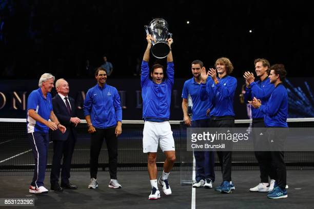Roger Federer of Team Europe lift the Laver Cup trophy with Marin Cilic Bjorn Borg Rafael Nadal Rod Laver Alexander Zverev Tomas Berdych and Dominic...