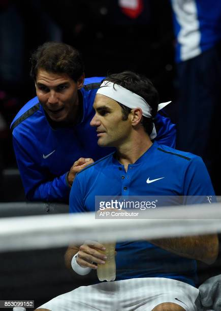 Roger Federer of Team Europe listens his teammate Rafael Nadal during his match against Nick Kyrgios of Team World at the Laver Cup on September 24...