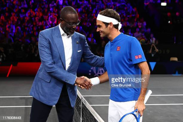 Roger Federer of Team Europe playing partner of Stefanos Tsitsipas shakes hands with Tidjane Thiam CEO of Credit Suisse prior to his doubles match...