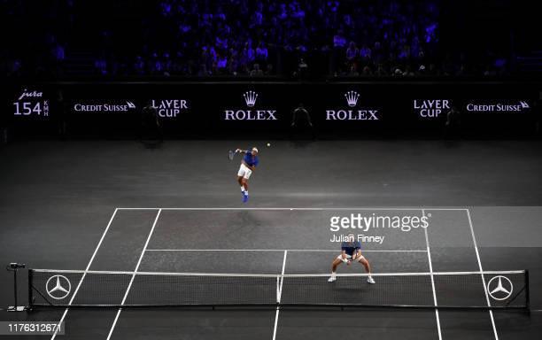 Roger Federer of Team Europe, playing partner of Stefanos Tsitsipas serves in his doubles match against John Isner and Jack Sock of Team World during...
