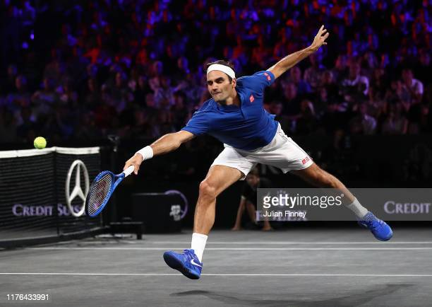 Roger Federer of Team Europe plays a backhand against John Isner of Team World during Day Three of the Laver Cup 2019 at Palexpo on September 22,...
