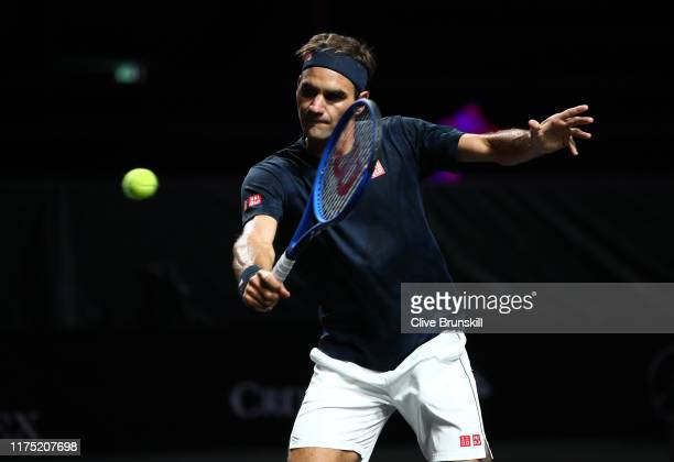 Roger Federer of Team Europe plays a backhand volley during a practice session prior to the Laver Cup at Palexpo on September 17, 2019 in Geneva,...