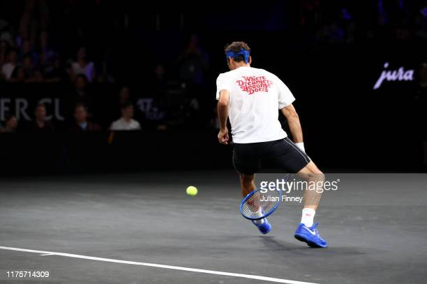 Roger Federer of Team Europe plays a shot between his legs during a practice session ahead of the Laver Cup 2019 at Palexpo on September 19, 2019 in...
