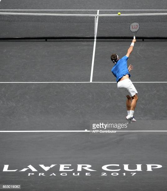 Roger Federer of Team Europe serves a ball to Nick Kyrgios of Team World during third day of Laver Cup on September 24 2017 in O2 Arena in Prague /...