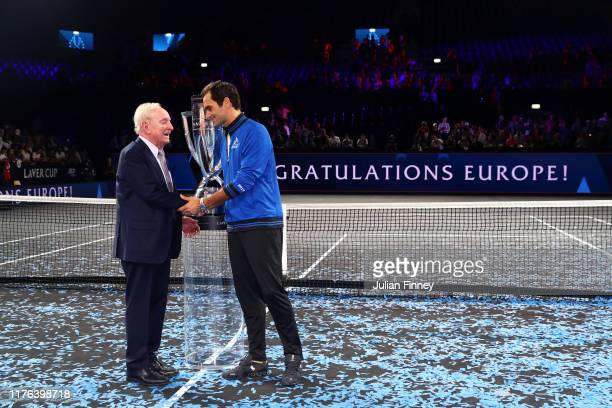 Roger Federer of Team Europe shakes hands with Rod Laver after winning the Laver Cup during Day Three of the Laver Cup 2019 at Palexpo on September...