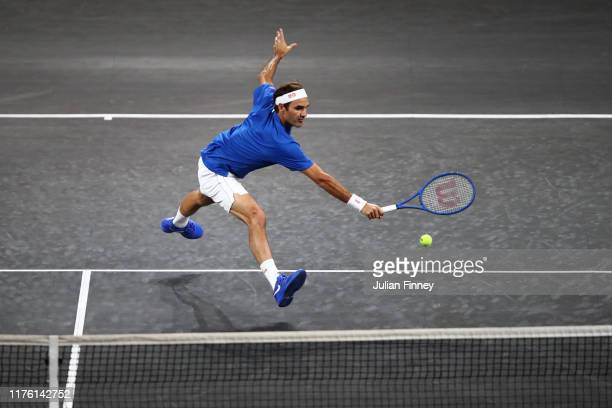Roger Federer of Team Europe stretches to play a backhand in his singles match against Nick Kyrgios of Team World during Day Two of the Laver Cup...