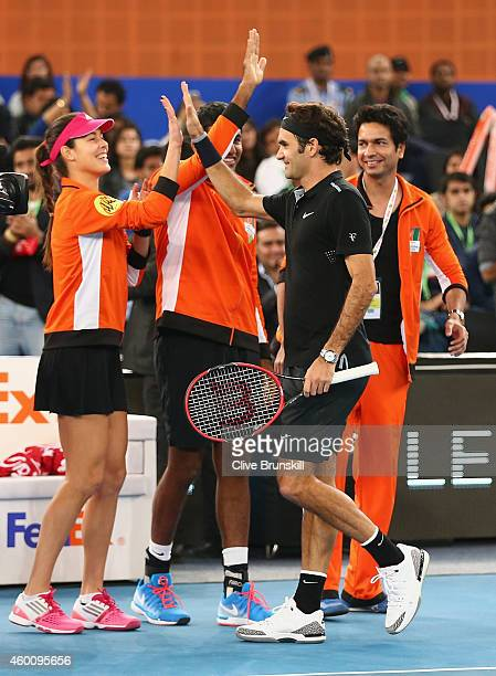 Roger Federer of the Indian Aces cogratulated by his team mate Ana Ivanovic after his victory in his match against Tomas Berdych of the Singapore...