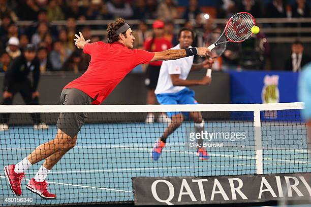 Roger Federer of the Indian Aces in action with Gael Monfils during their victory against Novak Djokovic and Marin Cilic of the UAE Royals during the...