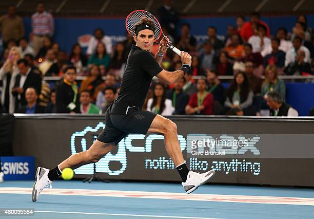 Roger Federer of the Indian Aces plays a backhand against Tomas Berdych of the Singapore Slammers during the Coca-Cola International Premier Tennis...