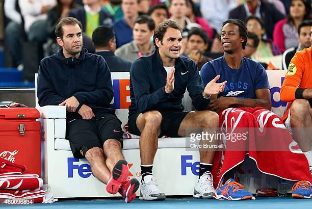 Roger Federer of the Indian Aces sits on the team bench with Pete Sampras and Gael Monfils during their teams match against the Singapore Slammers...
