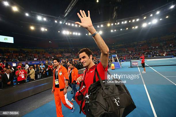 Roger Federer of the Indian Aces waves good buy to the crowd and Delhi after his teams match against the UAE Royals during the Coca-Cola...